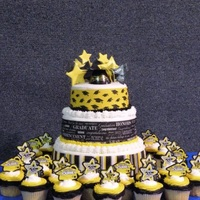 Black N Gold Grad Cake Cake was made using designer strips, pic and grad cap from Decopac. I made the stars using gumpaste.