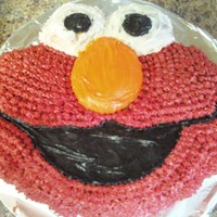 2Nd Birthday Wilton Elmo pan. Used star tip 18 to create the furry effect. Gently smoothed frosting for the other parts using cornstarch on wet finger....