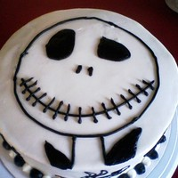 Jack Skellington Chocolate Almond cake with Cookies and French Buttercream filling. Everything was fine until trying to put the circle on for Jack's...