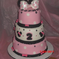 Minnie Mouse  Dominican Cake, Bottom tier has Pineapple filling, Middle tier Guava, Top tier Dulce de Leche, wih dominican supiro covered in MMFondant......
