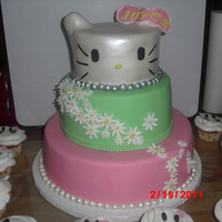 Hello Kitty  Dominican Cake, 2 top tier strawberry banana filling, bottom tier Pineapple filling, covered in MMFondant, ears in rice krispies, flowers...