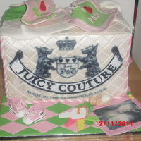 Juicy Couture Diaper Bag  6 layer cakes, top 2 tiers Dominican Cake with Pineapple filling, middle tier Butter Cake with French Vanilla Buttercreme filling, last 2...