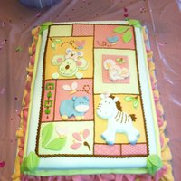 Baby Shower Animal Themed Cake The mother to be wanted me to match her nursery theme so I tried to replicate the quilt she bought with all the animals. White almond cake...