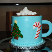 Hot Chocolate Four layer alternating chocolate and vanilla cake and buttercream frosting with fondant accents. I made this for my daughter's holiday...