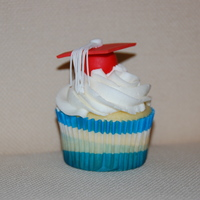 Graduation Cupcake I made these for my daughter's pre-k class for their graduation party. Buttercream with fondant cap.