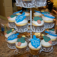 Hanukkah And Christmas Cupcakes Buttercream icing with fondant toppers.