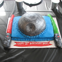 Death Star / Light Saber Cake Buttercream and MMF. Light Sabers are fondant covered rice crispie treats