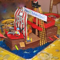 Pirate Ship Cake  This is a cake I made for my son's 6th birthday. The cake base is made in a 9X13 pan, layered and cut to the shape of a ship. The...