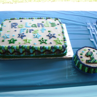 Boy Stars First Birthday Cake My third cake!! For my son's first birthday. Cake matched his invitations. Half chocolate and half white, with buttercream frosting.