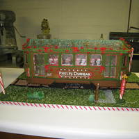 Gingerbread Streetcar This a gingerbread New Orleans streetcar I made for a friend's office party. The faces are partners in the law firm.