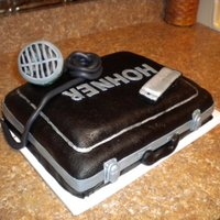 Harmonica Cake  This is my own birthday cake. I am a professional harmonica player, and this is my harmonica case,harmonica, and microphone. There is also...