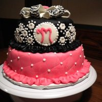 Black And Pink Baby Shower   I made this cake for a small baby shower. Both layers covered in MF, and the bow is made out of MF. TFL!