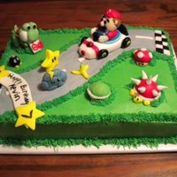 Mario Kart Birthday Cake  I made this cake for a 7 yr olds birthday. One of my first cakes. It's covered in buttercream and the road and figures are made out of...