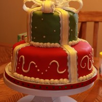 Christmas Gift Cake Top tier = matcha green tea cakeBottom tier = red velvet cake