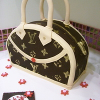 Purse Cake This Louis Vuitton birthday cake. Covered with chocolate fondant and details made of gum paste; letters stenciled with gold dust.