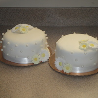 Simple White Wedding Cakes These were actually made for a tasting. The bride wanted to see a mini version of what her cake would look like. One is Lemon with...