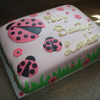 Pink & Green Ladybug Birthday/baptism Lemon Cake with fresh Raspberry filling and cream cheese icing. Covered in MMF and all decorations are MMF. This cake was for a little girl...