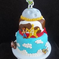 Toy Story Cake Made for my nephew's 4th birthday. Chocolate fudge cake with white chocolate ganache filling. Moon is RKT , cake is covered in MMF and...
