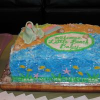 Beach Baby Shower Cake Niece wanted a beach-themed shower cake. Made baby and blanket and fish from fondant. Rest is buttercream.