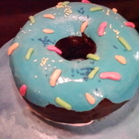 Giant Chocolate Donut With Blue Frosting My nephew was turning 4, and wanted me to make his cake. I asked him what he wanted...I told him he could have anything he wanted. He chose...