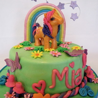 Pony And Rainbow Birthday Cake the pony is made of modeling chocolate, and the rainbow is gumpaste and fondant.