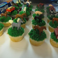 "Farm Animal Cupcakes   Cupcakes with piped ""grass"" in green BC."