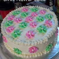Swirl Flower Cake I made a lot of swirl flowers out of BC and decided to use them on a cake.