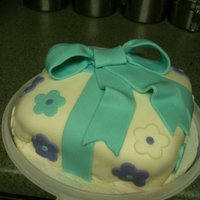 Gift Cake   Wilton Course cake, fondant covered, fondant bow & flower cut outs.
