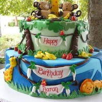 Aaron's First Birthday This cake was done for a wonderful family through Icing Smiles. Aaron is momma's little monkey and the party theme was monkey/ jungle...