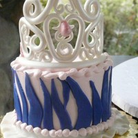 Princess Smash Cake Gumpaste crown with a ruffle skirt border. Buttercream with fondant stripes.