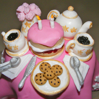 Tea For 2 Fondant tea party (atop a texas muffin) to celebrate a little girl's 2nd birthday party, hence the two candles on the cake! Tiny and...