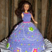 Princess Cake My granddaughter wanted a purple princess cake for her 4th birthday. She helped me make it !