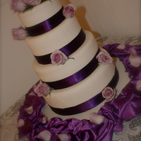 Violet Hues This client wanted a simple but elegant cake for her wedding. It is a four tier french vanilla cake with raspberry cream cheese filling....