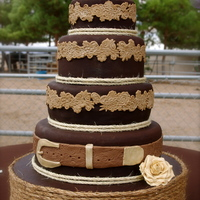 Western Wedding Cake. I was asked to make this cake for an outside western themed wedding. Its made of chocolate fondant with white cake and cream cheese filling...