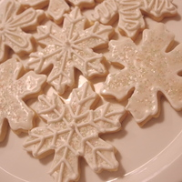 Snowflake Sugar Cookies snowflake sugar cookies with a icing glaze and decorated with opal sugar crystals and royal icing. Enjoy!