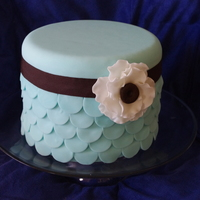 Blue Scalloped Cake This is a Tiffany Blue cake with a layered scalloped design with a anemone flower to finish. Thanks for looking