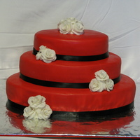 Red/black/white Oval Red 3 Tier Oval Wedding CakeBottom layer - Devil's Food Chocolate; Middle Layer - Swiss Chocolate; Top Layer - White; covered in...