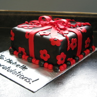 Black & Red Gift Cake Chocolate MMF tinted black with red fondant bow/flowers. White cake with raspberry filling