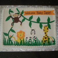 Safari Shower Cake this is a sheet cake (gasp!) iced in buttercream with fondant decorations.