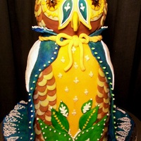 Majestic Owl :d I made this nolvelty/sculpted cake for my Advanced Patisserie class. I think I'm going to go over it one more time with the airbrush...