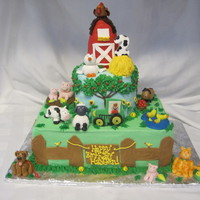 Farm Theme Cake This is a farm theme cake for a 2 year old boy. The animals are all made out of fondant and the barn is rice krispy treats covered in...