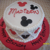 Mickey Cake Red Velvet cake with vanilla bc. Mickey heads are done in mm fondant and writing is in Disney font. TFL!