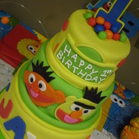 Bert & Ernie 1St Birthday Cake Cake is marble with vanilla buttercream, covered in MM fondant.