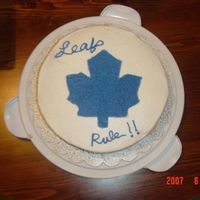 Toronto Maple Leafs Cake made for my son's 12 Birthday. The words were not turning out right during the transfer, so I gave up, and piped in blue stars