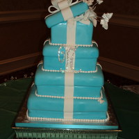 Tiffany Box With Butterflies Teal Tiffany box with butterflies, fondant square cake.