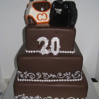 20Th Anniversary Chocolate fondant with Silver decoration.Top: Purse and Security Vest, represent the couples!