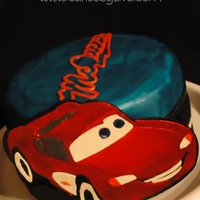 Lightning Mcqueen I made this cake for a client's nephew. Lightning McQueen and the McQueen logo are hand-carved out of gumpaste. The cake is...