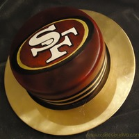 49Ers This is a cake that I made for my husband's birthday. He is a big 49ers fan (obviously). The logo is hand carved out of gumpaste, and...