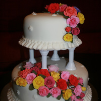 Rose Elegance   Two-tiered wedding cake with colorful gumpaste roses
