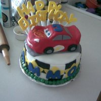 Lightening Mcqueen Cake (4Th Cake) This was my fourth cake. The car is made from cake and I carved it to look like lightening Mcqueen. The letters are gumpaste. I didnt have...
